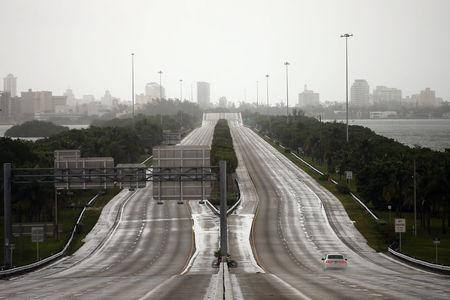 A car drives along an empty highway in Miami before the arrival of Hurricane Irma to south Florida, September 9, 2017. REUTERS/Carlos Barria