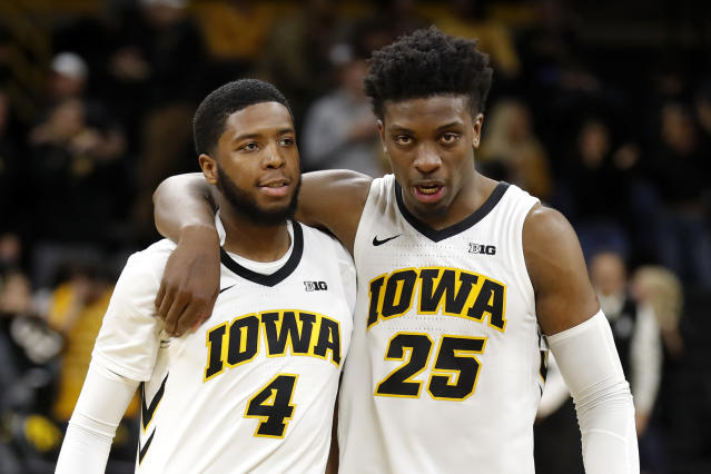 Iowa guard Isaiah Moss (4) walks off the court with teammate Tyler Cook after an NCAA college basketball game against Bryant, Saturday, Dec. 29, 2018, in Iowa City, Iowa. Iowa won 72-67. (AP Photo/Charlie Neibergall)