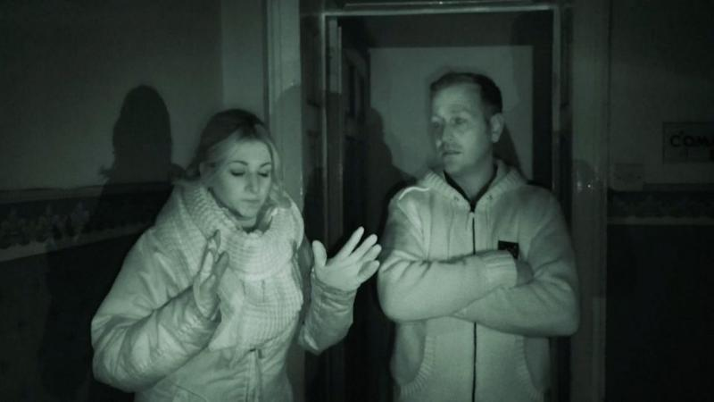 Ghost hunters Rebecca and Sean explore the Freemason's hall. Photo: Caters News