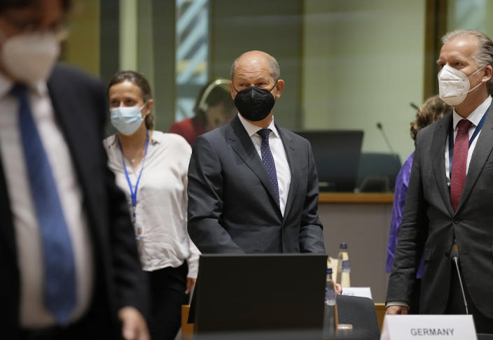 German Finance Minister Olaf Scholz, center, attends a meeting of the eurogroup finance ministers at the European Council building in Brussels on Monday, July 12, 2021. (AP Photo/Virginia Mayo)