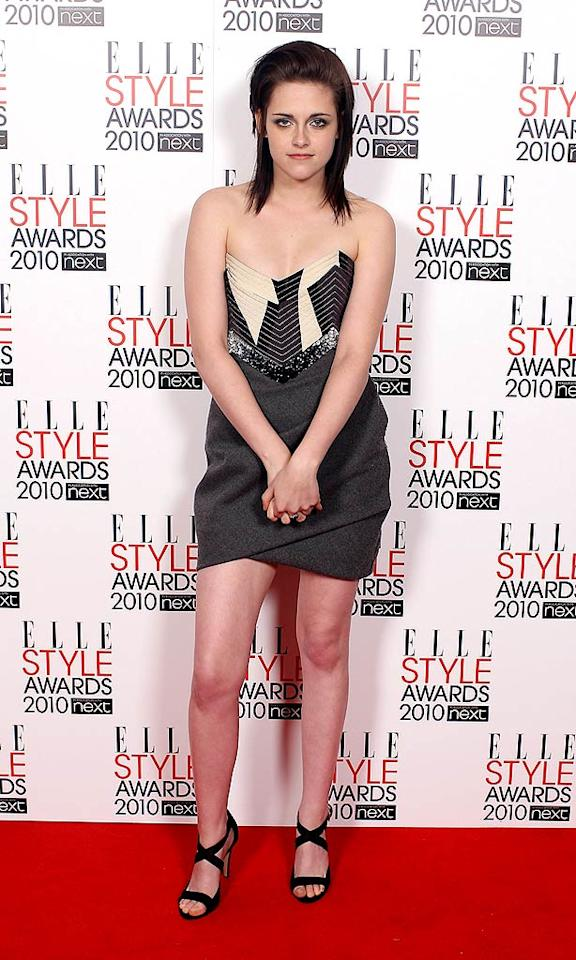"Kristen Stewart struck an uncomfortable pose in a gray mini and strappy heels. The ""Twilight"" star clearly does not enjoy life in the limelight! Mike Marsland/<a href=""http://www.wireimage.com"" target=""new"">WireImage.com</a> - February 22, 2010"