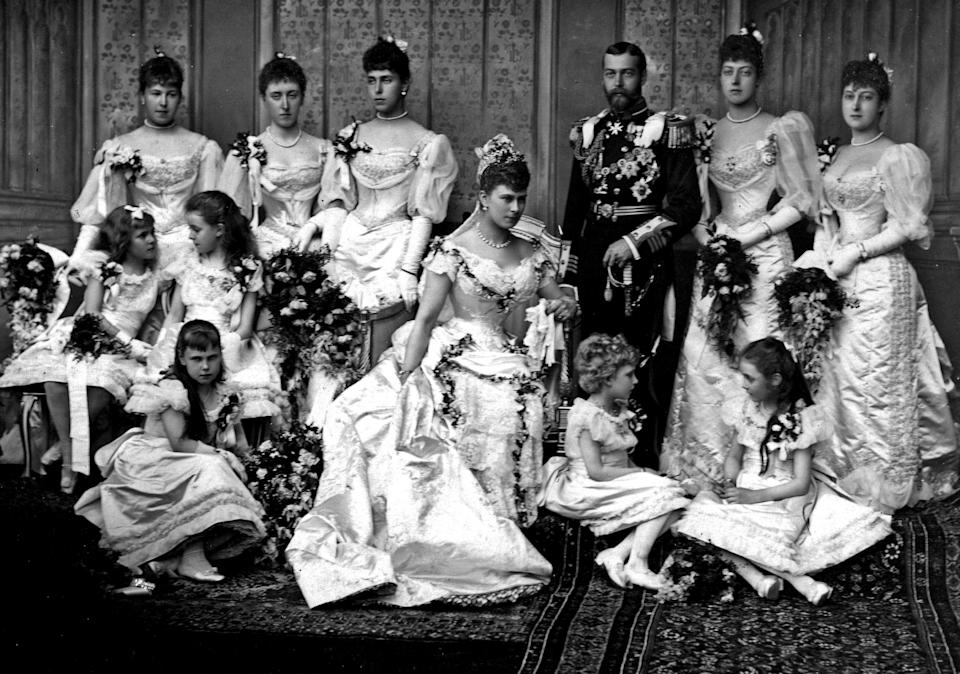 Portrait photograph in Buckingham Palace from the wedding of King George V and Princess Mary of Teck. Showing the family all posed in a group in their wedding clothes. Photograph taken in 1893. (Photo by: Universal History Archive/Universal Images Group via Getty Images)