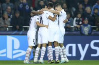Teammates celebrate after PSG's Mauro Icardi scored the opening goal of the match during a Champions League Group A soccer match between Club Brugge and Paris Saint Germain at the Jan Breydel stadium in Bruges, Belgium, Tuesday, Oct. 22, 2019. (AP Photo/Francisco Seco)