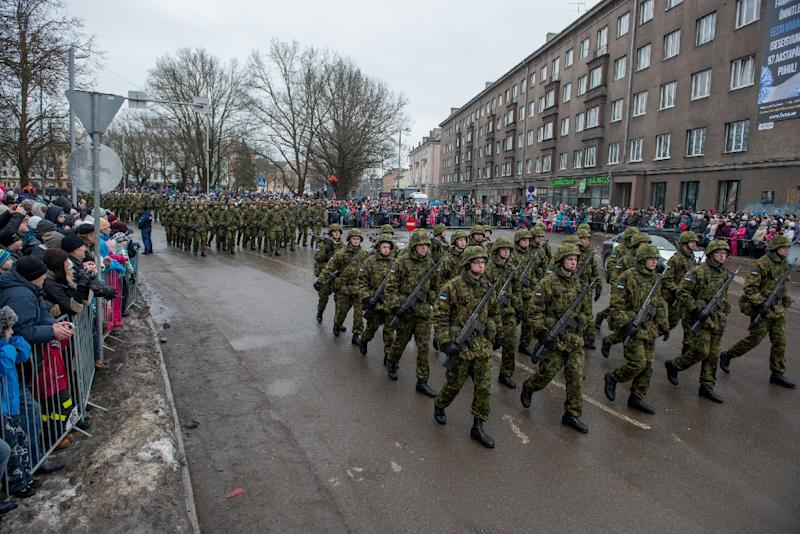 Estonian soldiers take part in a parade during an event to celebrate 97 years since first achieving independence in 1918, on February 24, 2015 in Narva, Estonia