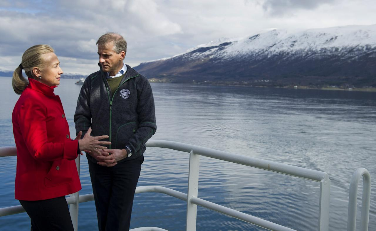 US Secretary of State Hillary Rodham Clinton and Norway's Minister of Foreign Affairs Jonas Gahr Stoere, right, talk together onboard the Arctic Research vessel Helmer Hanssen on a fjord, near the northern Norwegian city of Tromso, Norway, Saturday June 2, 2012. Clinton is trekking north of the Arctic Circle, a region that could become a new international battleground for resources. (AP Photo/Saul Loeb, Pool)