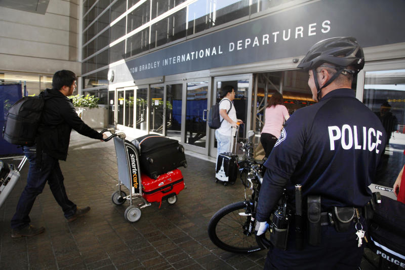 Police: Curious worker set off LAX dry ice bombs