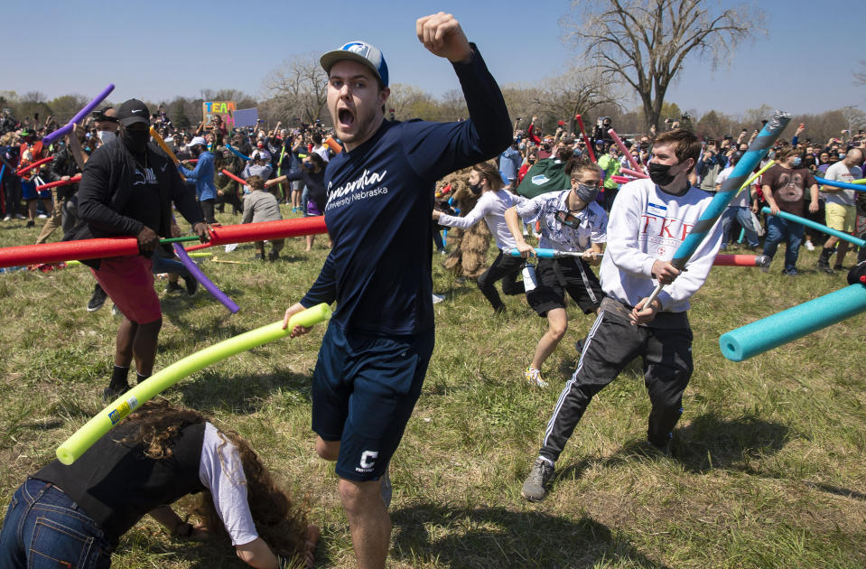 Multiple people with the name Josh duked it out with pool noodle out to find out who is the rightful owner of the name Josh via a battle royale in an open green space in Air Park on Saturday, April 24, 2021, in Lincoln, Neb. What started as a mid-pandemic joke took on life Saturday, as a mixed bag of individuals sharing only their name came to battle it out. The winner was to be declared the rightful owner of the name. (Kenneth Ferriera/Lincoln Journal Star via AP)