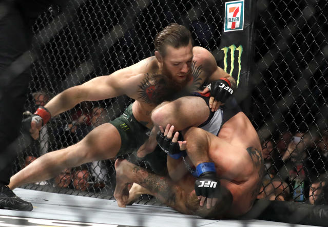 Conor McGregor punches Donald Cerrone in a welterweight bout during UFC 246 at T-Mobile Arena on Jan. 18, 2020 in Las Vegas. McGregor won by first-round TKO. (Steve Marcus/Getty Images)