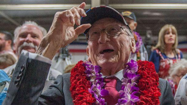PHOTO: In this file photo taken on Dec. 7, 2016, USS Arizona survivor Donald Stratton, center, acknowledges a friend at Kilo Pier next to the World War II Valor in the Pacific National Monument at Joint Base Pearl Harbor-Hickam in Honolulu, Hawaii. (Eugene Tanner/AP)