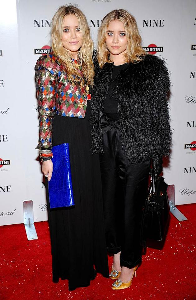 "Mary-Kate Olsen and her sister Ashley (who appears to be wearing a Yeti) embarrassed themselves yet again on the red carpet at an A-list event in New York. Will the 23-year-old former ""Full House"" cuties ever get a clue, a stylist, or a mirror? Probably not. Dimitrios Kambouris/<a href=""http://www.gettyimages.com/"" target=""new"">GettyImages.com</a> - December 15, 2009"