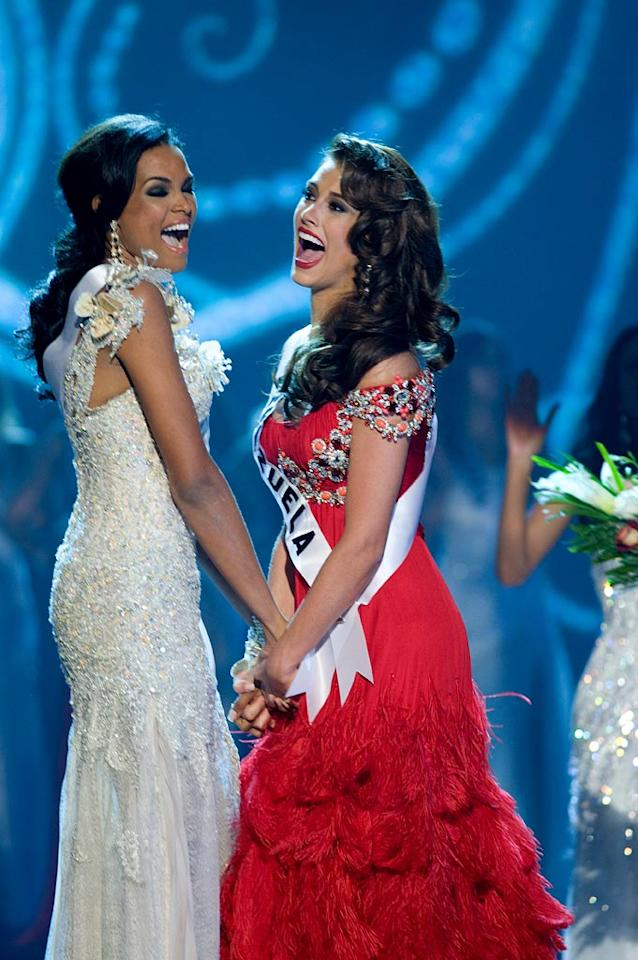 The final two contestants react as hosts Billy Bush and Claudia Jordan announce the first runner up, Ada Aimee De la Cruz, Miss Dominican Republic 2009, and the Miss Universe Crown by Diamond Nexus Labs goes to Stefania Fernandez, Miss Venezuela 2009, taking the title of Miss Universe 2009.