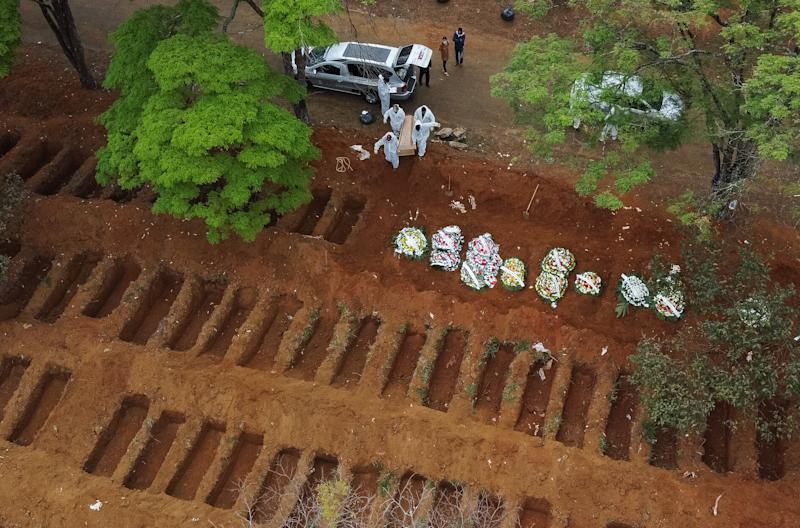 SAO PAULO, BRAZIL - JULY 16: An aerial view of Vila Formosa cemetery as open graves are being prepared amidst the coronavirus (COVID-19) pandemic on July 16, 2020 in Sao Paulo, Brazil. Brazil is reaching two million confirmed cases of coronavirus (COVID-19). The country is second only to the United States in number of cases and deaths. According to the Brazilian Health Ministry, Brazil has over 75.000 deaths. (Photo by Alexandre Schneider/Getty Images)