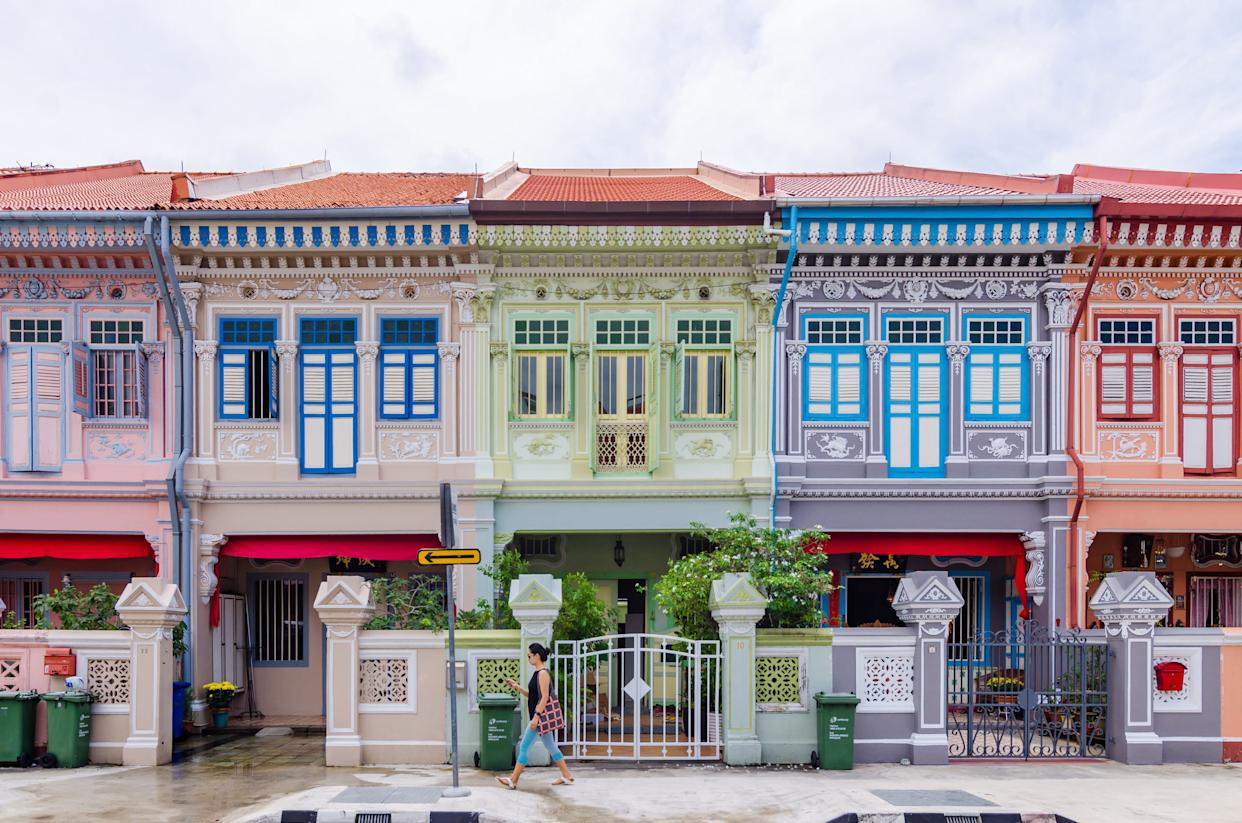 While traveling through Asia, Rachel seesPeranakan terrace houses (à la the ones pictured above on Joo Chiat Road in Singapore). The book also mentions that Astrid owns a row of historic Peranakan shop houses on Singapore's Emerald Hill.