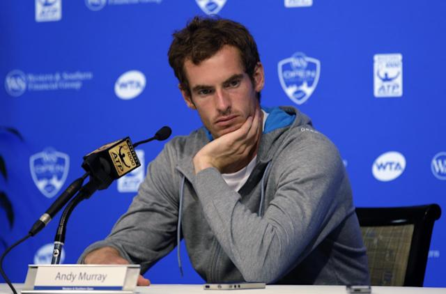 Andy Murray, of Great Britain, answers questions during a news conference at the Western & Southern Open tennis tournament, Sunday, Aug. 10, 2014, in Mason, Ohio. Murray, the eighth seed, has won the event two times. (AP Photo/Al Behrman)