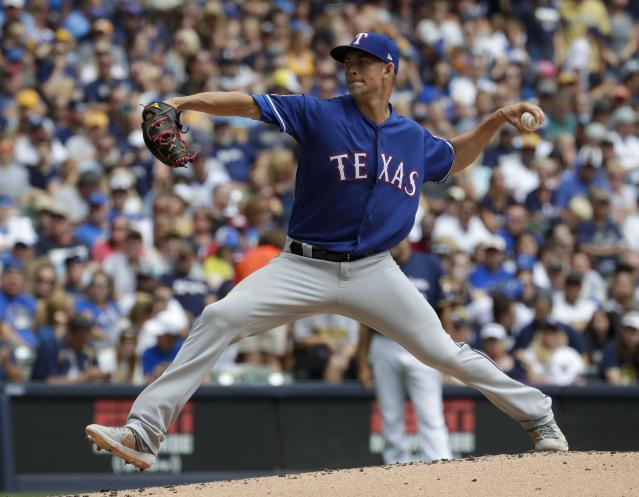 Texas Rangers starting pitcher Mike Minor throws during the first inning of a baseball game against the Milwaukee Brewers Sunday, Aug. 11, 2019, in Milwaukee. (AP Photo/Morry Gash)