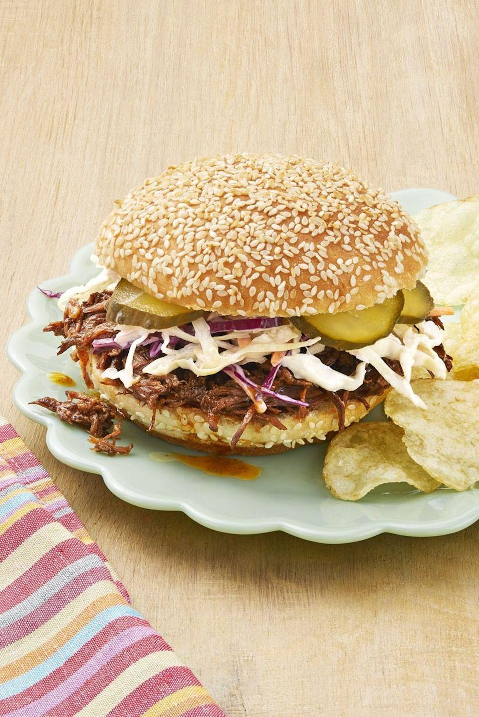 """<p>You'll feel full and ready to tackle game day, thanks to these shredded beef sandwiches. Top them with tangy coleslaw and pickles for a snappy crunch.</p><p><strong><a href=""""https://www.thepioneerwoman.com/food-cooking/recipes/a32530495/instant-pot-bbq-beef-sandwiches-recipe/"""" rel=""""nofollow noopener"""" target=""""_blank"""" data-ylk=""""slk:Get the recipe."""" class=""""link rapid-noclick-resp"""">Get the recipe.</a></strong></p><p><strong><a class=""""link rapid-noclick-resp"""" href=""""https://go.redirectingat.com?id=74968X1596630&url=https%3A%2F%2Fwww.walmart.com%2Fbrowse%2Fthe-pioneer-woman-kitchen-appliances%2Fc2hlbGZfaWQ6ODEwOQieie&sref=https%3A%2F%2Fwww.thepioneerwoman.com%2Ffood-cooking%2Fmeals-menus%2Fg35049189%2Fsuper-bowl-food-recipes%2F"""" rel=""""nofollow noopener"""" target=""""_blank"""" data-ylk=""""slk:SHOP INSTANT POTS"""">SHOP INSTANT POTS</a><br></strong></p>"""