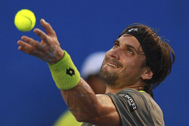 Spain's David Ferrer serves to South Africa's Kevin Anderson at the Mexican Tennis Open in Acapulco, Mexico, Thursday, Feb. 27, 2014. (AP Photo/Hugo Avila, JAM MEDIA)