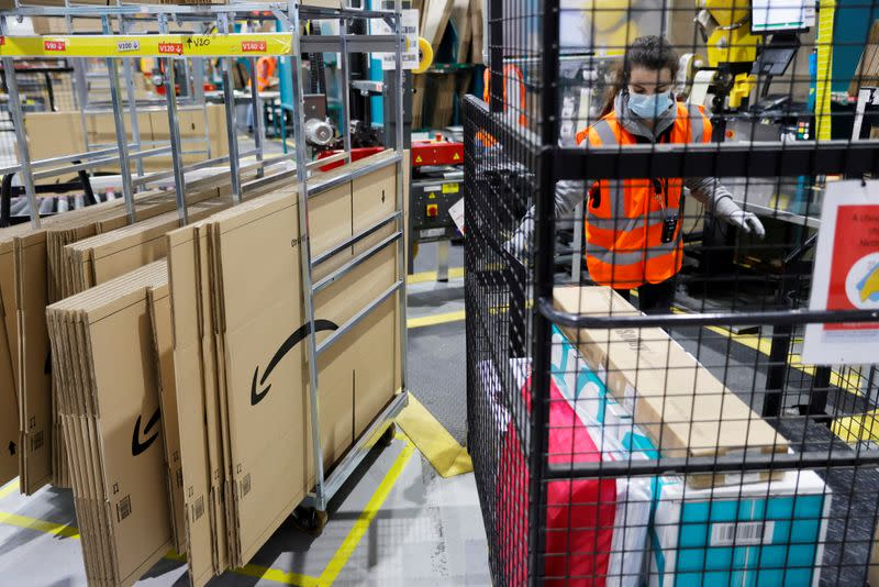 FILE PHOTO: Employees work at the Amazon fulfilment center in Boves near Amiens, France