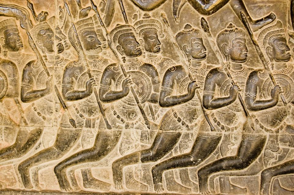 Bas relief carving of Kaurava foot soldiers heading at the Battle of Kurukshetra as described in the Mahabharata.  Western Gallery of Angkor Wat, Cambodia.  Sculpted around the eleventh century.