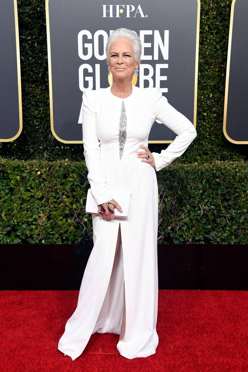 <p>Wearing a white long-sleeved dress.</p>