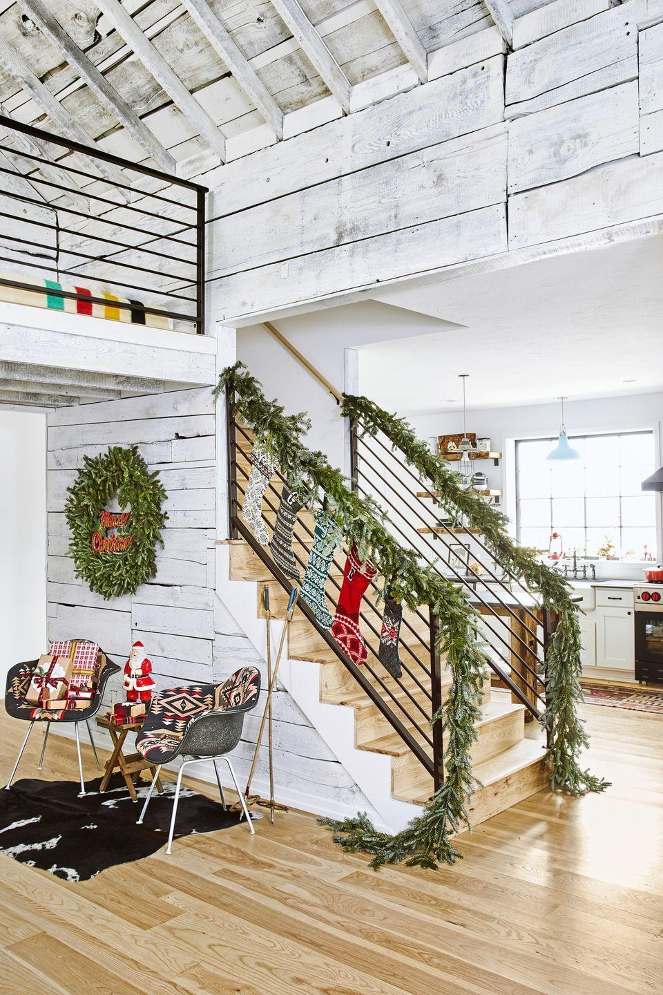 """<p>Every corner of this <a href=""""https://www.countryliving.com/home-design/house-tours/g25472073/chirstmas-decorating-michigan-farmhouse/"""" rel=""""nofollow noopener"""" target=""""_blank"""" data-ylk=""""slk:Michigan home"""" class=""""link rapid-noclick-resp"""">Michigan home</a>, owned by Christine and Gabe Bridger, is decked to the nines. That includes the staircase: Stockings and a garland keep it feeling fun and festive.</p><p><a class=""""link rapid-noclick-resp"""" href=""""https://www.amazon.com/wreaths-garlands/b?ie=UTF8&node=13679411&tag=syn-yahoo-20&ascsubtag=%5Bartid%7C10050.g.1247%5Bsrc%7Cyahoo-us"""" rel=""""nofollow noopener"""" target=""""_blank"""" data-ylk=""""slk:SHOP WREATHS AND GARLANDS"""">SHOP WREATHS AND GARLANDS</a></p>"""