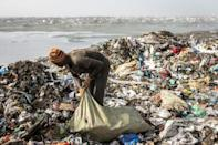 About 2,000 pickers ignore the stench and the fumes and make money by scavenging for plastic, iron and aluminium among the rubbish