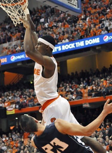 Syracuse's C.J. Fair draws a foul as he scores against Monmouth's Stephen Spinella during the first half of an NCAA college basketball game in Syracuse, N.Y., Saturday, Dec. 8, 2012. (AP Photo/Kevin Rivoli)