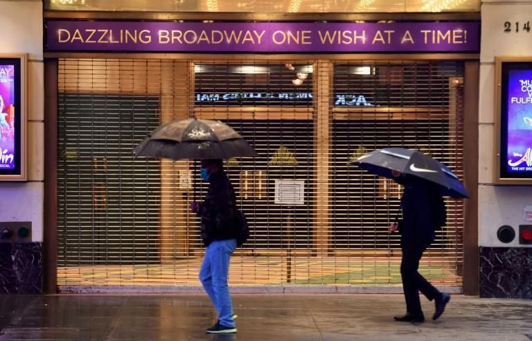 People walk past a closed broadway theater near Time Square on October 12, 2020 in New York City