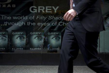 A man passes by an advertisement for 'Grey' outside a bookstore in New York, U.S. on June 18, 2015.    REUTERS/Brendan McDermid/File Photo