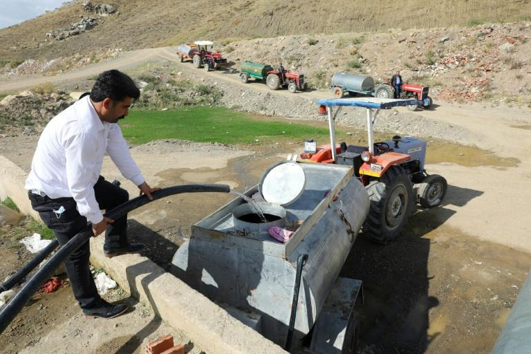 Severe droughts in Turkey have forced farmers to fill tanks with water (AFP/Adem ALTAN)