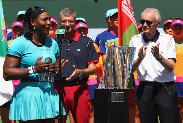 INDIAN WELLS, CA - MARCH 20: Serena Williams of USA talks to the crowd alongside Indian Wells CEO Raymond Moore after her loss to Victoria Azarenka of Belarus after the final during day fourteen of the BNP Paribas Open at Indian Wells Tennis Garden on March 20, 2016 in Indian Wells, California. (Photo by Julian Finney/Getty Images)