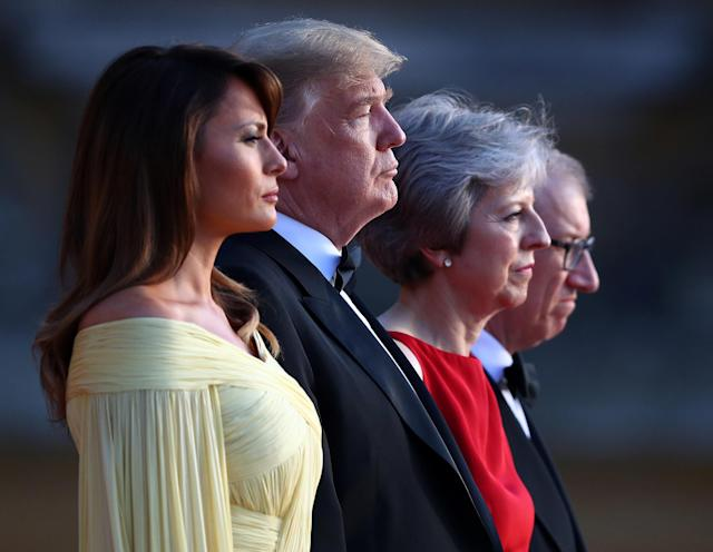 <p>British Prime Minster Theresa May and her husband Philip stand together with President Donald Trump and first lady Melania Trump at the entrance to Blenheim Palace, where they are attending a dinner with specially invited guests and business leaders, near Oxford, Britain, July 12, 2018. (Photo: Hannah McKay/Reuters) </p>