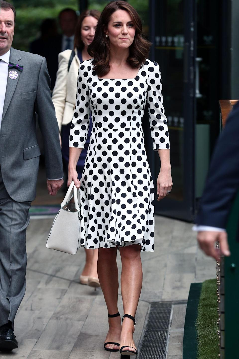 <p>The royal mom wore a <span>polka dot Dolce & Gabbana dress</span> as she headed to the iconic sports arena in London before the first match of the day. <strong>Get the look! </strong>Adrianna Papell Short-Sleeve Polka Dot Dress, $120; <span>bloomingdales.com</span></p>
