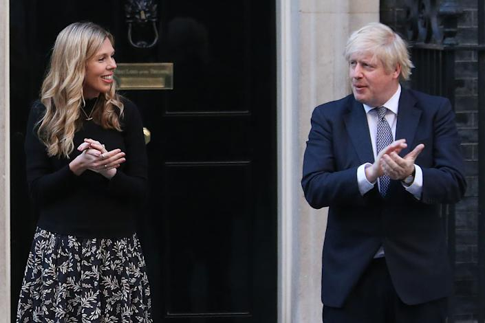 Matt thought the prime minister's experience with COVID would lead to greater appreciation for the NHS. Here Boris Johnson takes part in Clap for Carers with fiancée Carrie Symonds in 2020. (AFP via Getty Images)