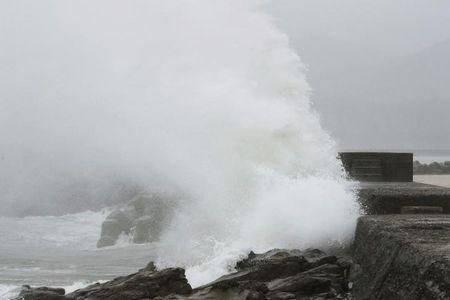 A wave, caused by Typhoon Noru, splashes the coast in Kushima