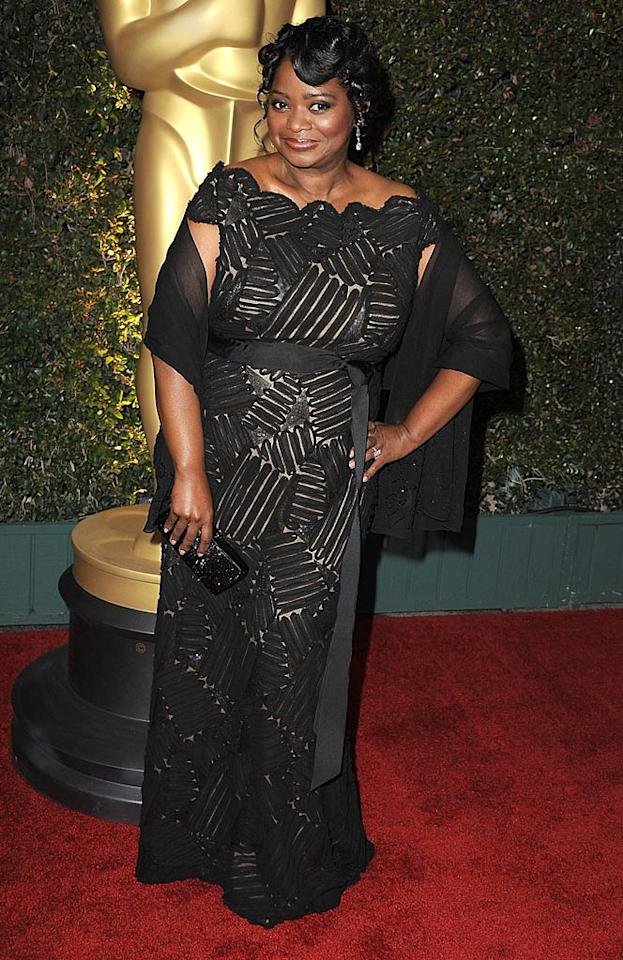 """Following in Davis' footsteps was her """"Help"""" co-star Octavia Spencer, who popped a pose in a dramatic Tadashi Shoji dress and diamond earrings. Hopefully we'll see both actresses back on the red carpet come the Academy Awards in February! (11/12/2011)"""
