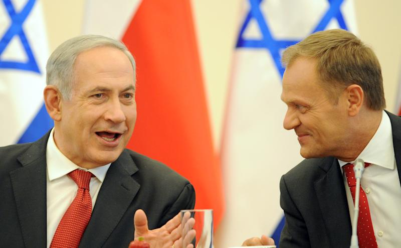 Israeli Prime Minister Benjamin Netanyahu, right, and his Polish counterpart Donald Tusk talk before a meeting with members of their governments in Warsaw, Poland, Wednesday, June 12, 2013. Netanyahu came to Poland for a two day visit for talks with Tusk and to attend the opening of a Holocaust exhibition in the former German Nazi Death Camp Auschwitz Birkenau. (AP Photo/Alik Keplicz)