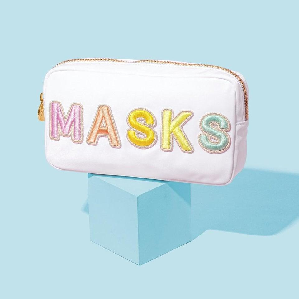 <p>Everyone needs this adorable <span>Stoney Clover Lane Blanc Small Masks Pouch</span> ($143) in their life.</p>