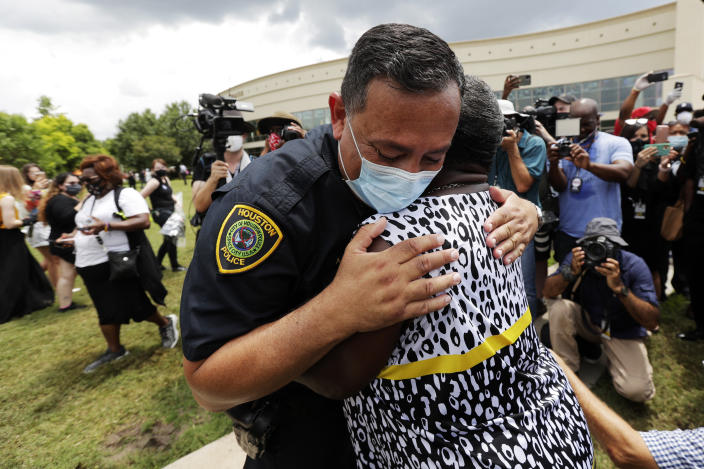 Houston Police Chief Art Acevedo embraces Charlene Davis after Davis prayed for him as she stood in line at a public visitation for George Floyd in Houston on June 8. (AP Photo/Eric Gay)