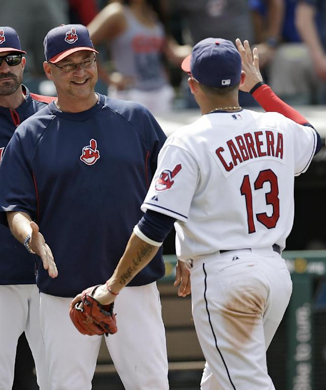 Cleveland Indians manager Terry Francona, left, congratulates Asdrubal Cabrera after the Indians defeated the Minnesota Twins 9-4 in a baseball game, Thursday, May 8, 2014, in Cleveland. (AP Photo/Tony Dejak)