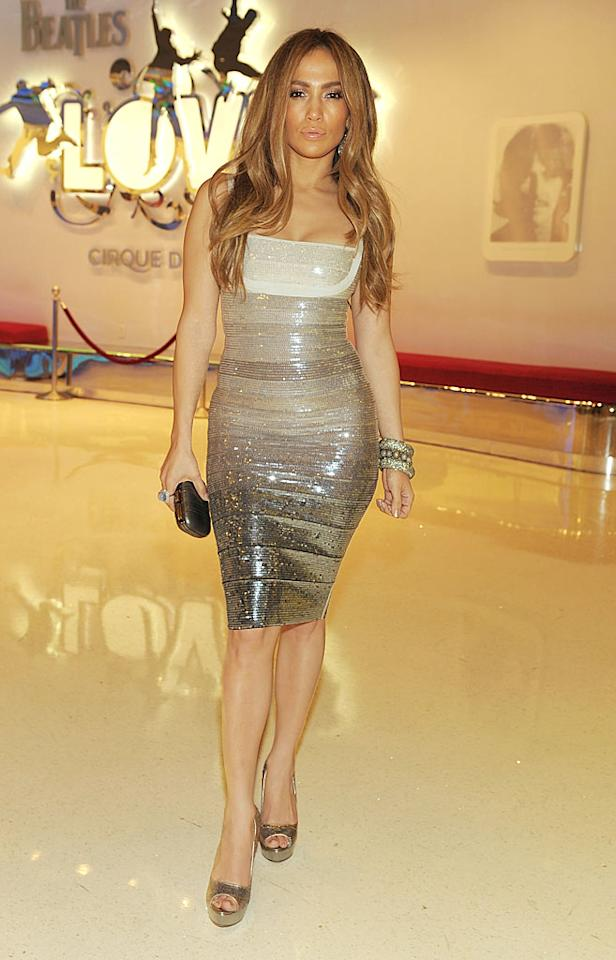"New ""American Idol"" judge Jennifer Lopez showed off her signature curves on New Year's Eve in a sexy sequined $2,500 Herve Leger bandage dress upon arriving at Love -- The Beatles Cirque du Soleil show -- at The Mirage in Las Vegas, Nevada. Caramel-colored locks, stacked bracelets, a diamond cocktail ring, and mirrored peep-toes completed her flawless look. Denise Truscello/<a href=""http://www.wireimage.com"" target=""new"">WireImage.com</a> - December 31, 2010"