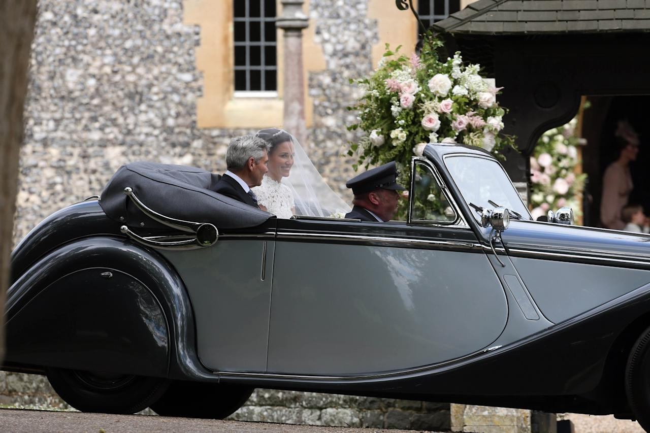 <p>The bride was chauffeured to her wedding ceremony in a Rolls Royce. Her father, Michael Middleton, accompanied her in the backseat. (Photo: AP) </p>