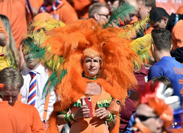 A Dutch supporter waits for the start of the group B World Cup soccer match between Australia and the Netherlands at the Estadio Beira-Rio in Porto Alegre, Brazil, Wednesday, June 18, 2014. (AP Photo/Martin Meissner)