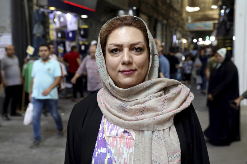 Nahroba Alirezei, a 35-year-old English-language teacher, is interviewed by The Associated Press at the old main bazaar in Tehran, Iran, Tuesday, July 2, 2019. While opinions differ across Tehran's Grand Bazaar about the ongoing tensions between the U.S. and Iran over its unraveling nuclear deal, there's one thing those in the beating heart of Iran's capital city agree on: American sanctions hurt the average person, not those in charge. (AP Photo/Ebrahim Noroozi)