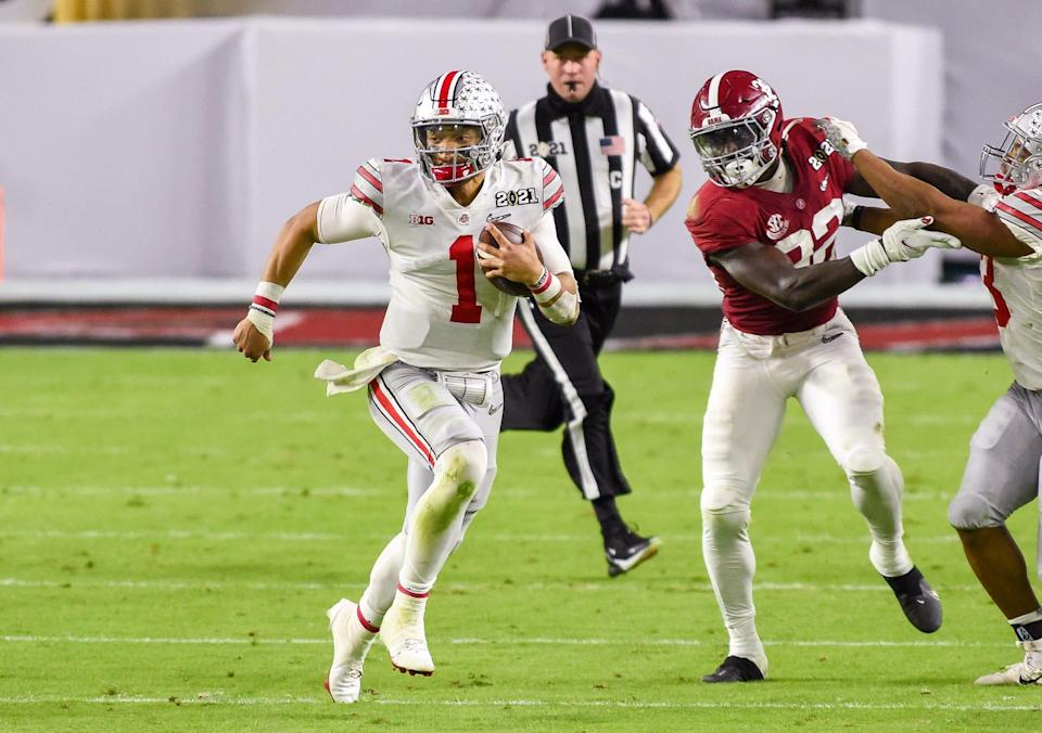Ohio State quarterback Justin Fields (1) scrambles during the third quarter at the College Football Playoff Championship Game at Hard Rock Stadium in Miami Gardens, Jan. 11, 2021.  The Crimson Tide defeated the Buckeyes 52-24.