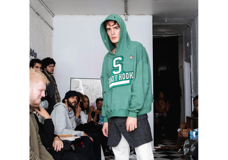 In this Friday, Sept. 13, 2019 photo provided by Bstroy, models at a show for fashion brand Bstroy wear hoodies emblazoned with the names of schools touched by mass shootings at an apartment in the Soho neighborhood of Manhattan in New York. The hoodies have created a backlash from critics who say they glamorize violence and aim to profit from tragedy. Bstroy co-founder Dieter Grams says the hoodies are an effort to bring attention to gun violence and are not for retail sale. (Bstroy via AP)
