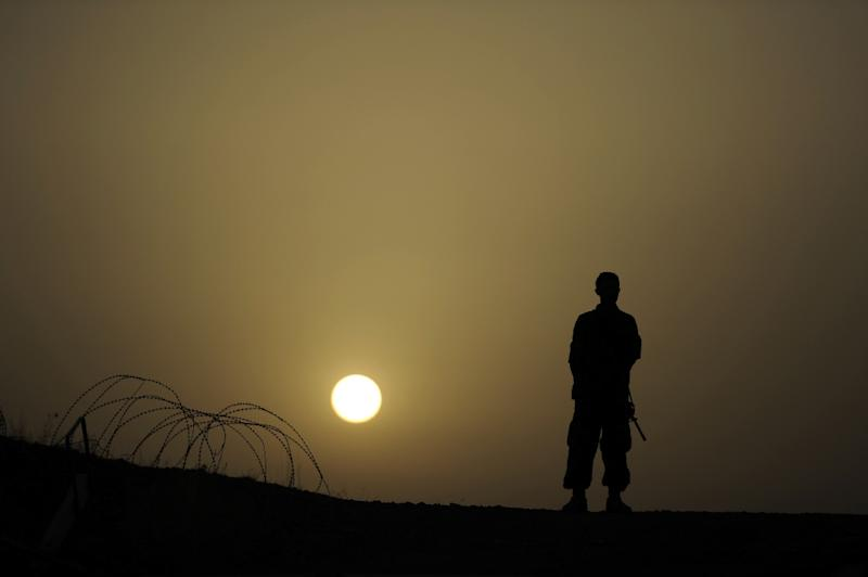 An Afghan soldier stands at a checkpoint in the Buwri Tana base, in Khost Province on August 7, 2012 (AFP Photo/Jose Cabezas)