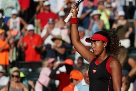 Mar 21, 2018; Key Biscayne, FL, USA; Naomi Osaka of Japan waves to the crowd after her match against Serena Williams of the United States (not pictured) on day two of the Miami Open at Tennis Center at Crandon Park. Osaka won 6-3, 6-2. Mandatory Credit: Geoff Burke-USA TODAY Sports