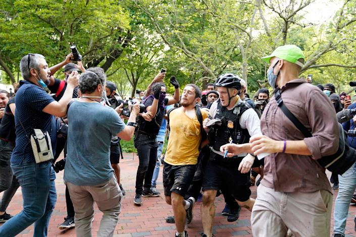 Uniformed U.S. Secret Service police detain a protester in Lafayette Park across from the White House as demonstrators protest the death of George Floyd, a black man who died in police custody in Minneapolis, Friday, May 29, 2020, in Washington. (AP Photo/Evan Vucci) ORG XMIT: DCEV337