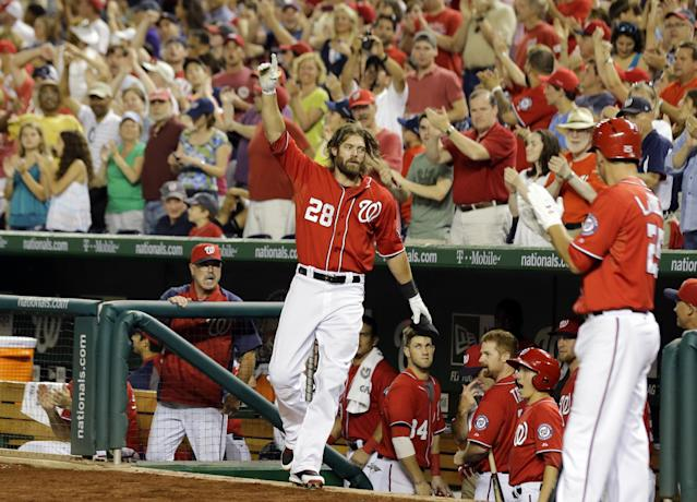 Washington Nationals' Jayson Werth (28) acknowledges the fans after his two-run home run during the seventh inning of a baseball game against the Philadelphia Phillies at Nationals Park, Saturday, Aug. 10, 2013, in Washington. (AP Photo/Alex Brandon)
